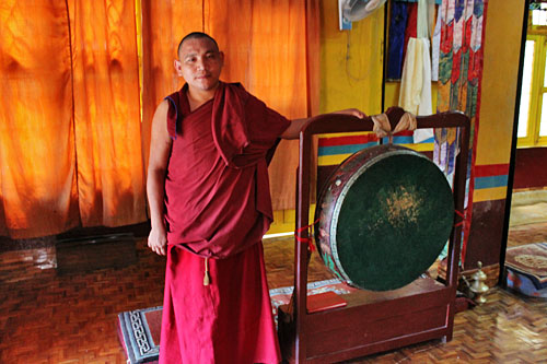 Monk shows me one of the larger drums