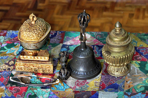 Bells and other items used in a puja ceremony