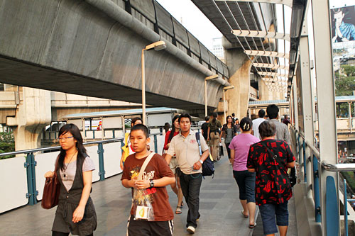 Pedestrians on the Sky Train (BTS) elevated walkway at Bangkok's Siam Square