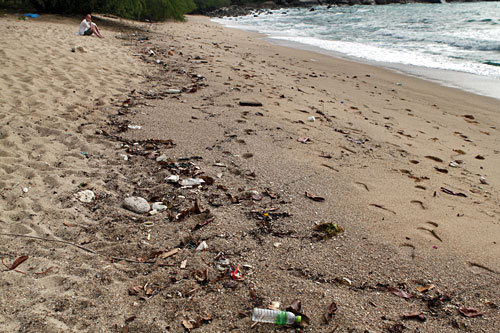Trash on the beach at The Sanctuary