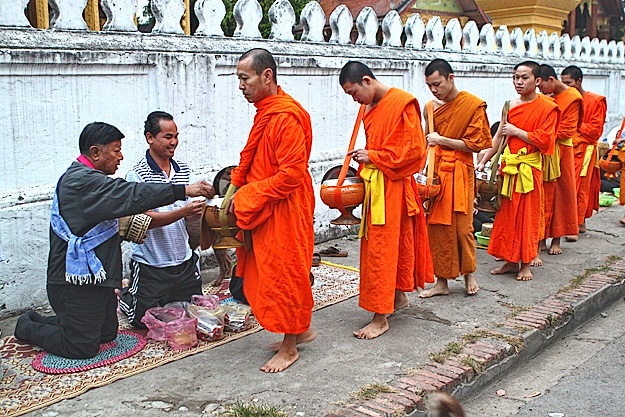 Giving alms to monks in Luang Prabang Laos