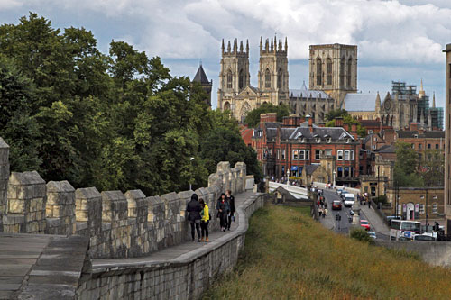 Walking the city walls around medieval York, with York Minster in the background