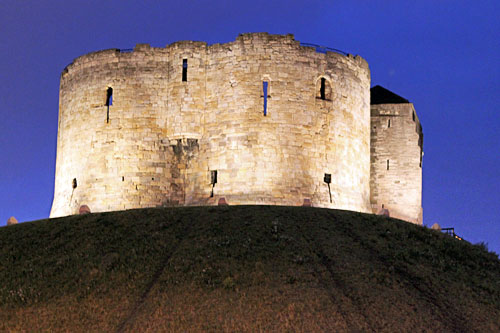 Spotlighted Clifford's Tower at night in York, England