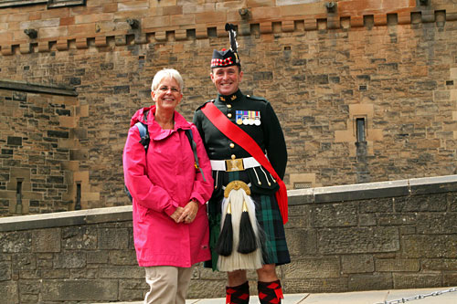 Posing with a member of the Scottish Guard in front of Edinburgh Castle
