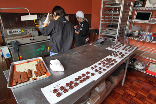 Working the chocolate assembly line, with every step done by hand