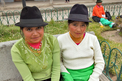 Young Quichua girls in traditional dress in Chugchilan's central plaza