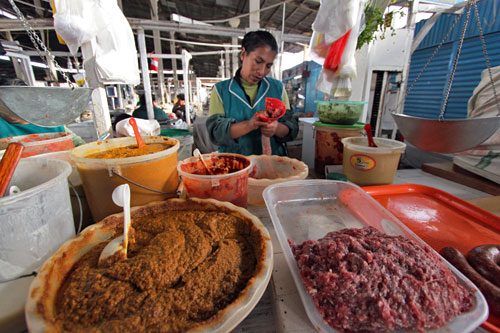Spicy, spicier, and spiciest sausages made fresh at the San Pedro Market in Cusco