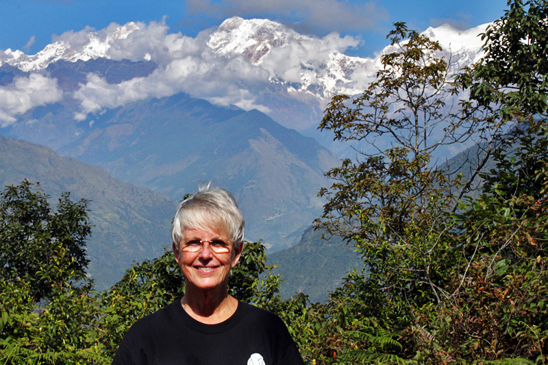 Barbara Weibel in Nepal, with the Annapurna Himalayas in the background