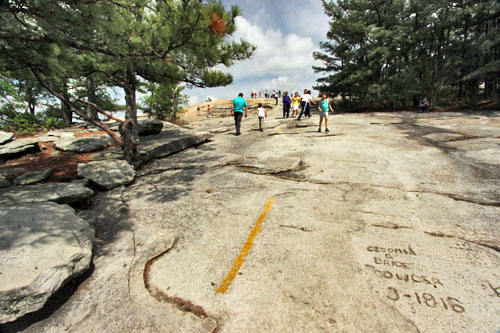 The steep trail to the top of Stone Mountain passes graffiti carved into the stone by visitors from the 19th and 20th centuries