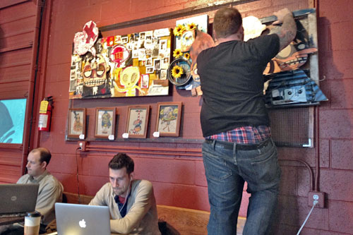 Local artist hangs a new show at REV Coffee
