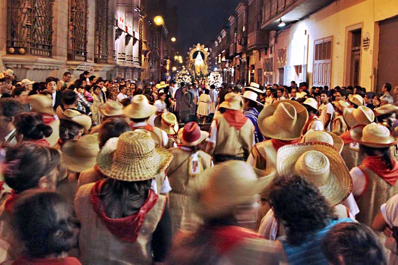 Catholic Worshipers Dance Though the Streets of Lima for Hours Behind Statue of Virgin de la Puerta