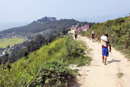 Trekking to Changu Narayan, here seen on the distant hilltop