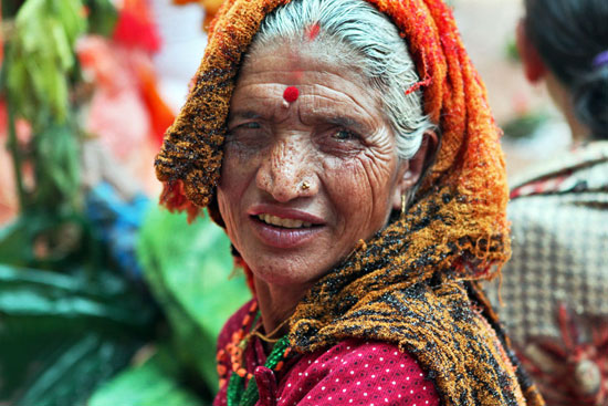 Woman attending a puja to honor a deceased relative in Nepal