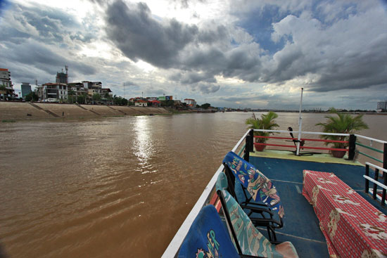 Cruising the Tonle Sap River in Phnom Penh on an overcast day