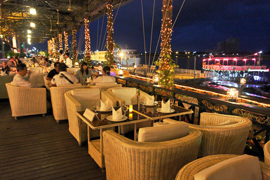 """After our boat ride we enjoyed dinner at a riverfront restaurant overlooking the """"real"""" sunset cruise boats"""