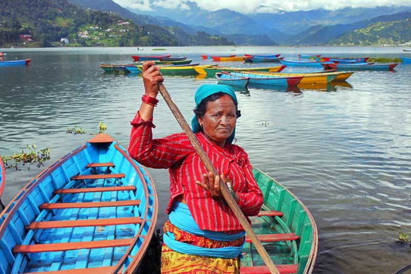 Boatwoman on Phewa Tal in Pokhara, Nepal