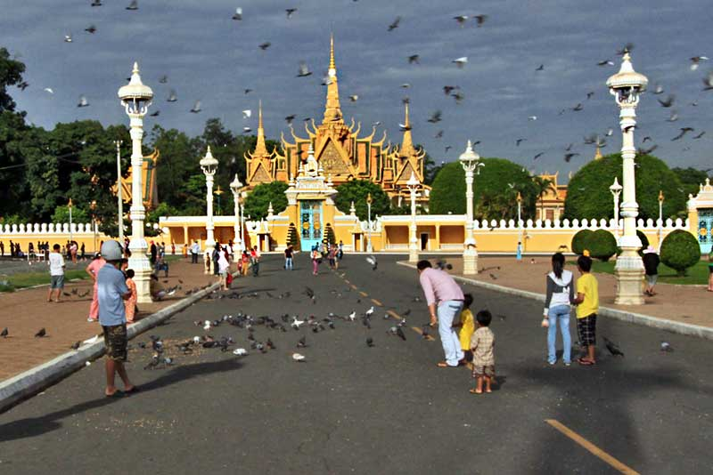 Visitors Feed Pigeons in Front of Royal Palace in Phnom Penh, Cambodia