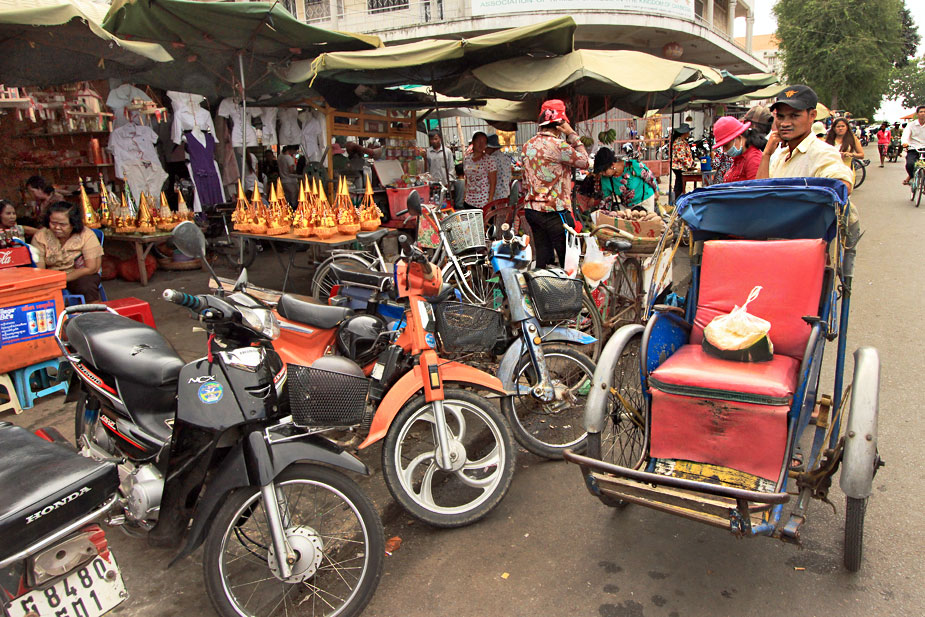 Streets of Phnom Penh, Cambodia are a Hodge-Podge of Rickshaws, Motorcycles, Bicycles and Pedestrians