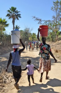 Family collecting water in Haiti, courtesy of Water.org and Passports with Purpose
