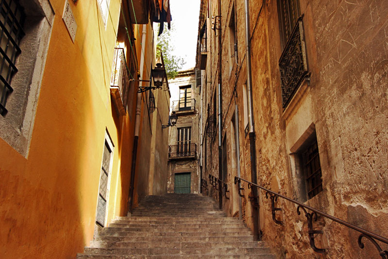 Narrow Lanes Climb Steeply in the Jewish Quarter in Old Town, Girona, Spain