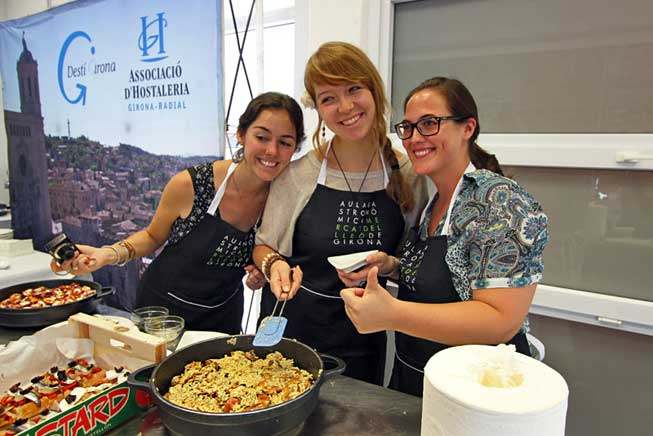 Classmates proudly show off their vegetarian Paella in our cooking class in Girona, Spain