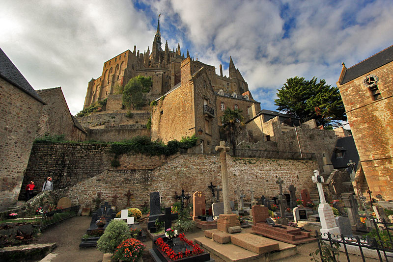 Cemetery Beneath Mont St. Michel Abbey and Fortress in Normandy, France