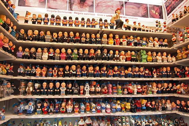 Caganers are so popular they are made with the faces of famous people. Some shown here include President Obama, Queen Elizabeth, Winston Churchill, Batman, Michael Jackson, John Lennon, and the entire national football (soccer) team.