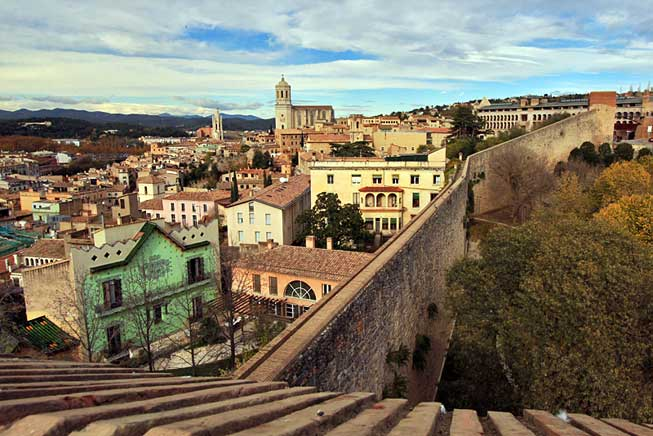 View over Girona and to the snow-capped Spanish Pyrenees from atop the Medieval city wall