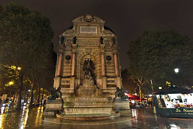 Saint Michel Place features a tall statue of St. Michael