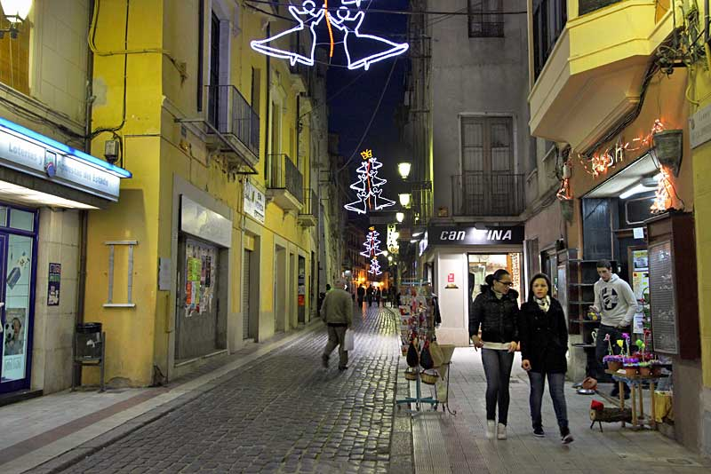 Christmas Decorations Above Pedestrian Shopping Street in Figueres, Spain