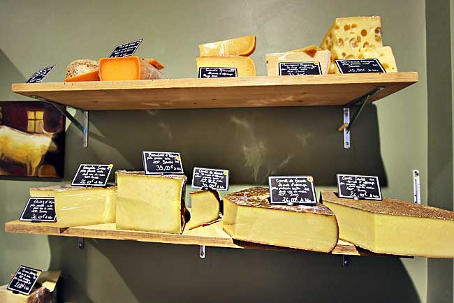 One whole shelf displays Comté, probably the most popular cheese in France
