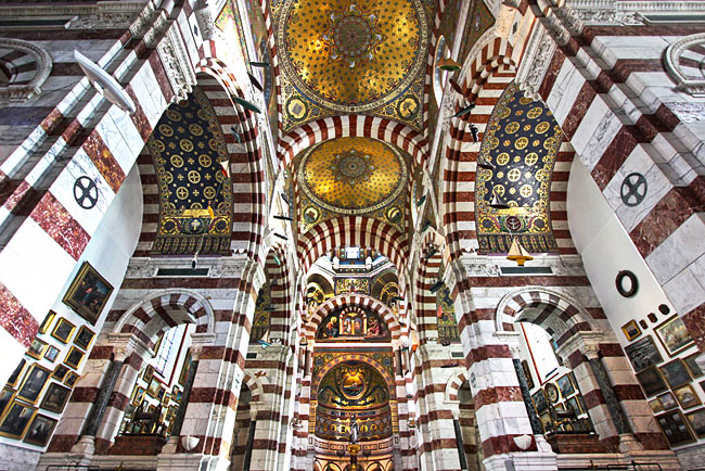 Interior of Notre Dame de la Garde Basilica in Marseille France is covered in 12 million glittering mosaics