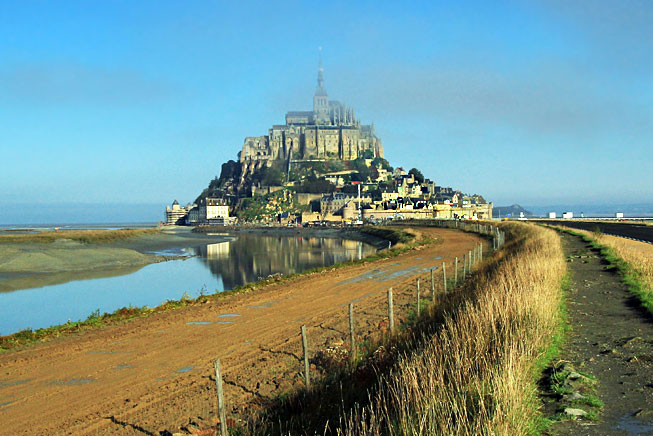 Mont Saint Michel emerges from the mists in Normandy France