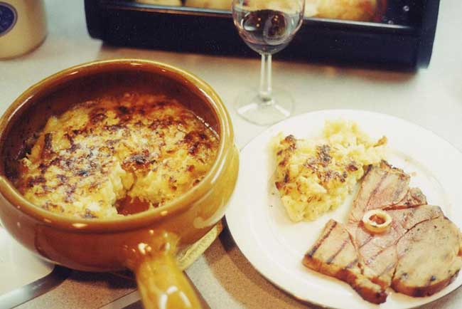Tartiflette casserole and fried ham, courtesy of Hayford Peirce, Wikipedia Commons