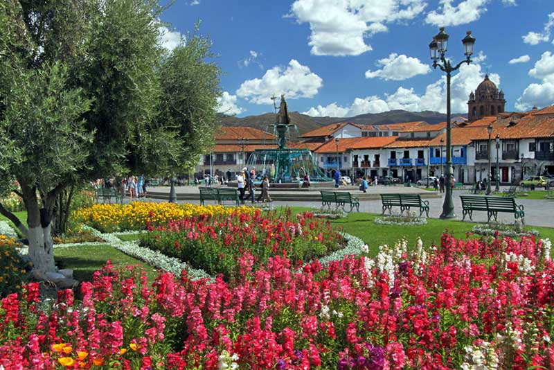 Blooming Flowers and a Burbling Fountain Grace Plaza de Armas, the Central Square in Cusco, Peru