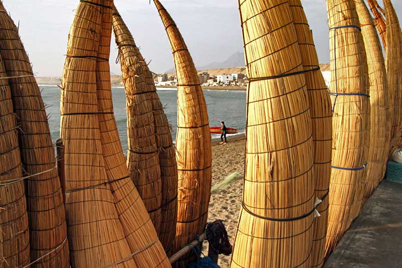 Reed Boats Line the Shore in Huanchaco, Just North of Trujillo, Peru