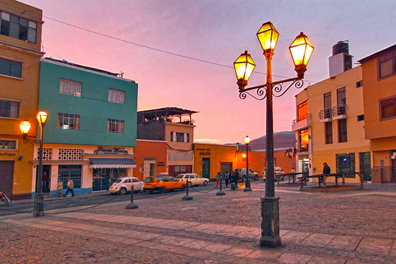 Old-fashioned Street Lamps Provide Romantic Lighting at Sunset in Trujillo, Peru