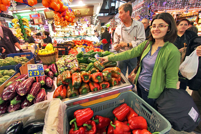 Checking out the produce at Santa Caterina Market with fellow travel blogger Isabel Romano