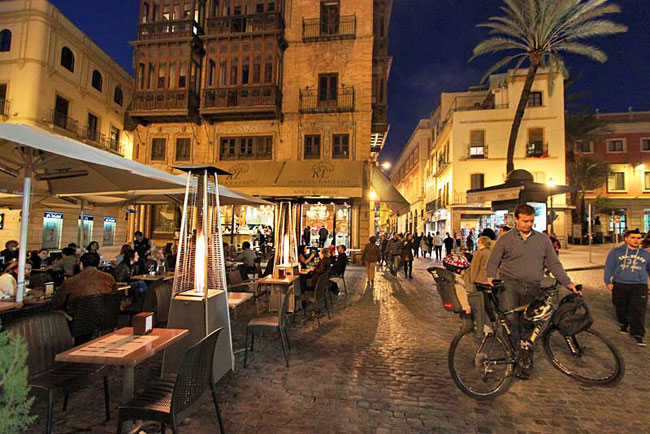 By night, the squares of Seville Spain are filled with locals enjoying life