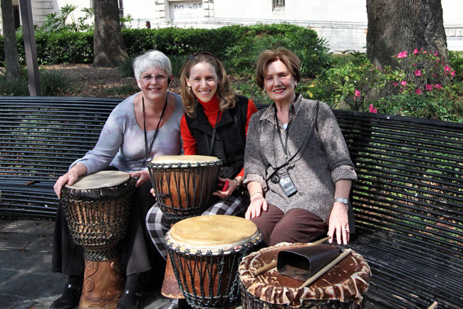 Barbara Weibel playing bongo drums in New Orleans' Congo Square with other participants of the Tauck Jazz Event