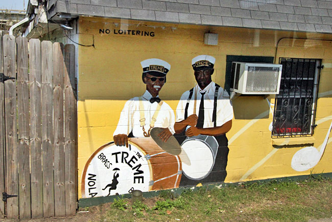 Uncle Lionel Batiste, bass drummer for Treme Bass Band until he died last year, is immortalized with another band member on the wall of the Candlelight Lounge, located in New Orlean's Treme neighborhood