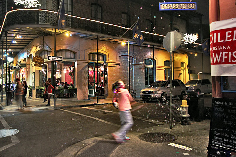 Young Girl Chases Bubbles on Bourbon Street in the French Quarter of New Orleans