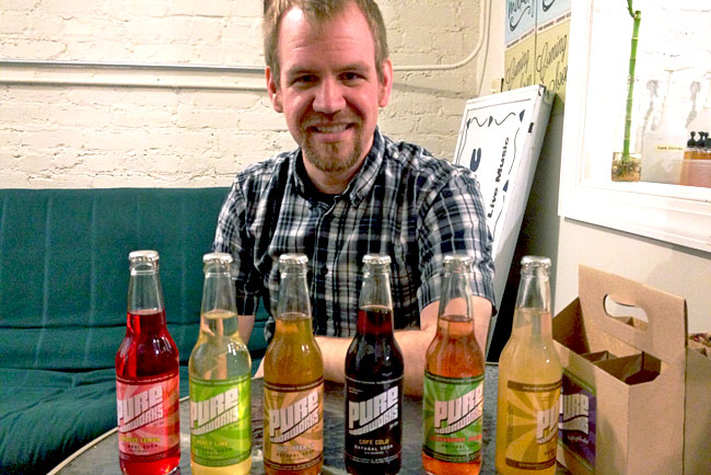Matt Rogers displays his natural hand-crafted line of Pure Sodaworks, located on Chattanooga's North Shore