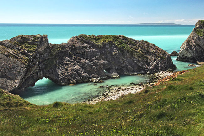 Crashing waves have carved arches in this finger of Portland limestone known as Stair Hole