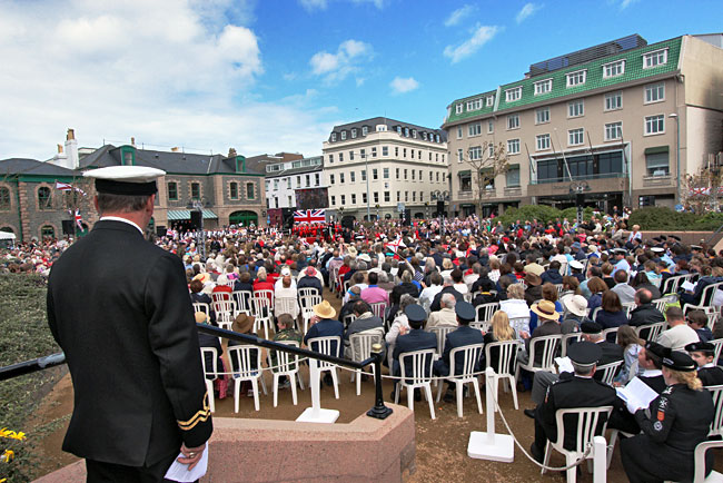 Celebrants await the annual re-enactment of the liberation of the Isle of Jersey at the end of WWII