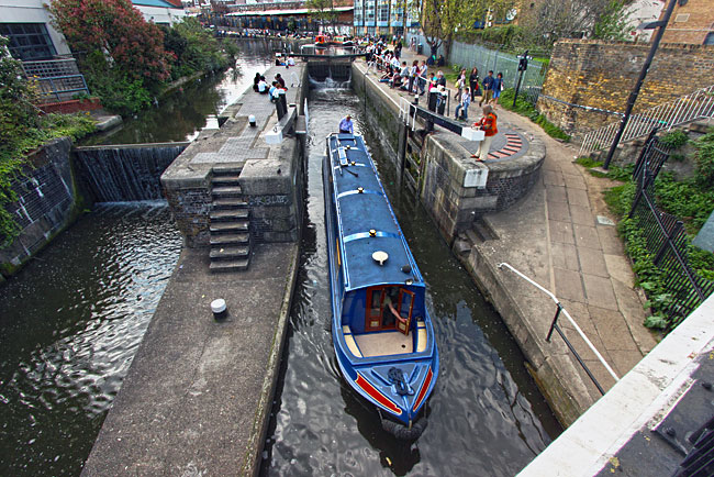 Narrowboat plies the locks on the Regent Canal at Camden, London