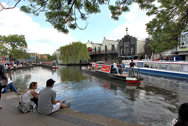 Narrowboats cruise along Regent's Canal in Camden, London