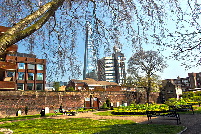 Rescued from demolition, wall of the old Marshalsea Prison now encloses a lovely church garden