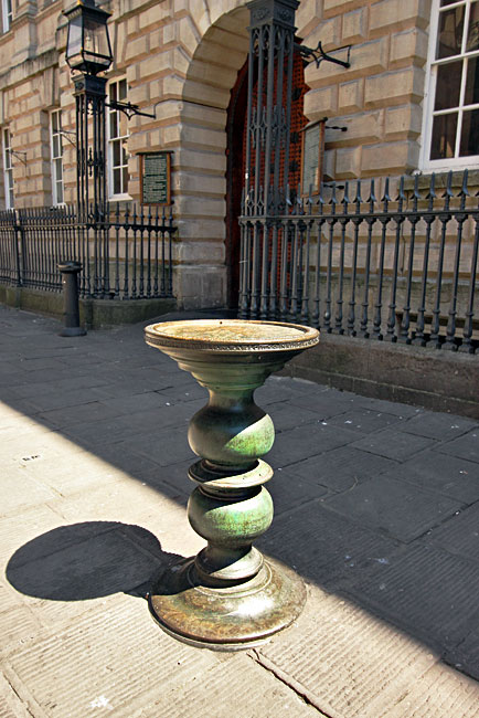 Bronze trading pillar in front of The Exchange on Corn Street, in Bristol's old financial district, where merchants met to buy goods from arriving ships