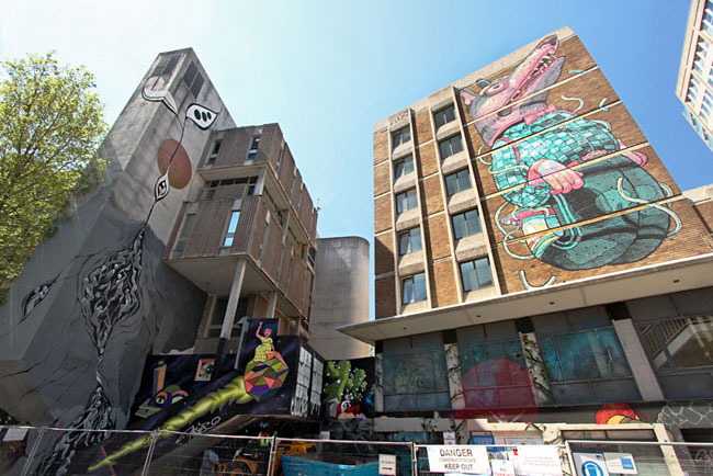 Buildings on Nelson Street display large murals that are during the See No Evil street art event